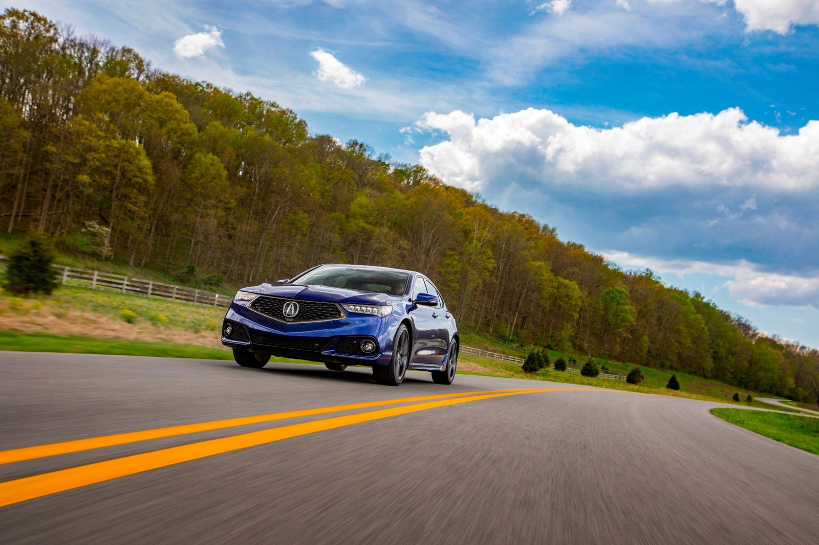 Blue Acura TLX front profile
