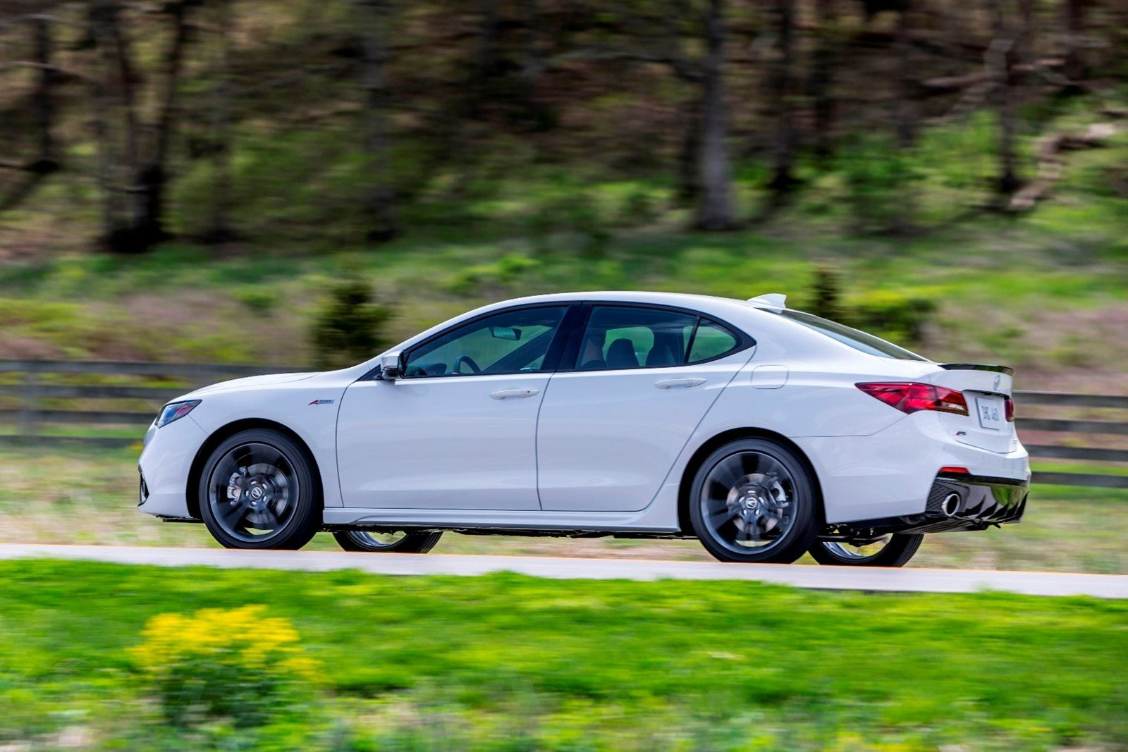 White Acura TLX side view