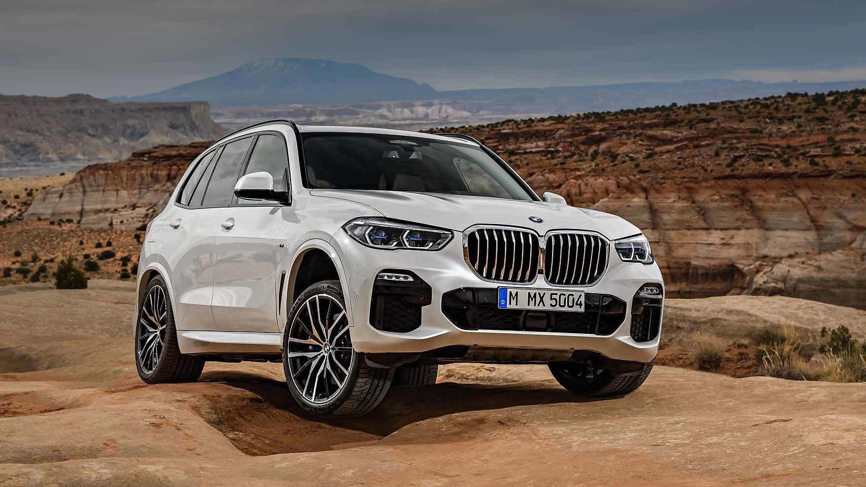 2020 bmw x5 m50i on dunes in white color