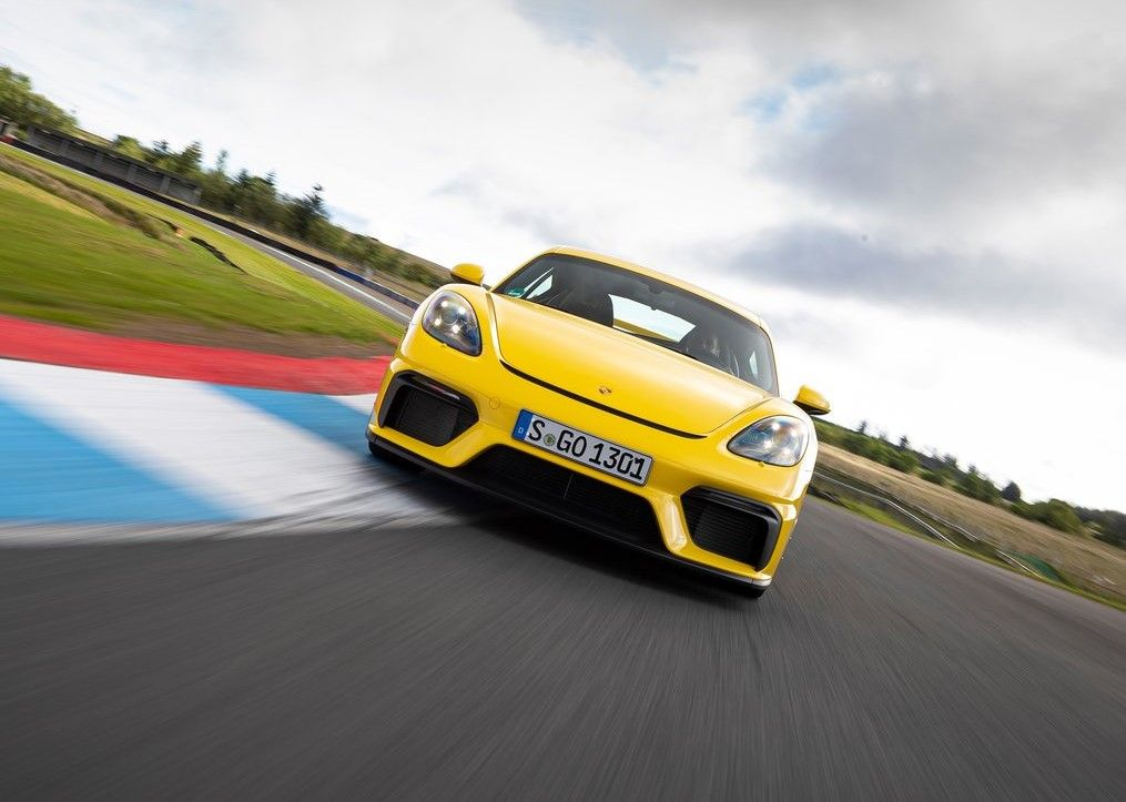 yellow 2020 Porsche 718 Cayman GT4 track front angle