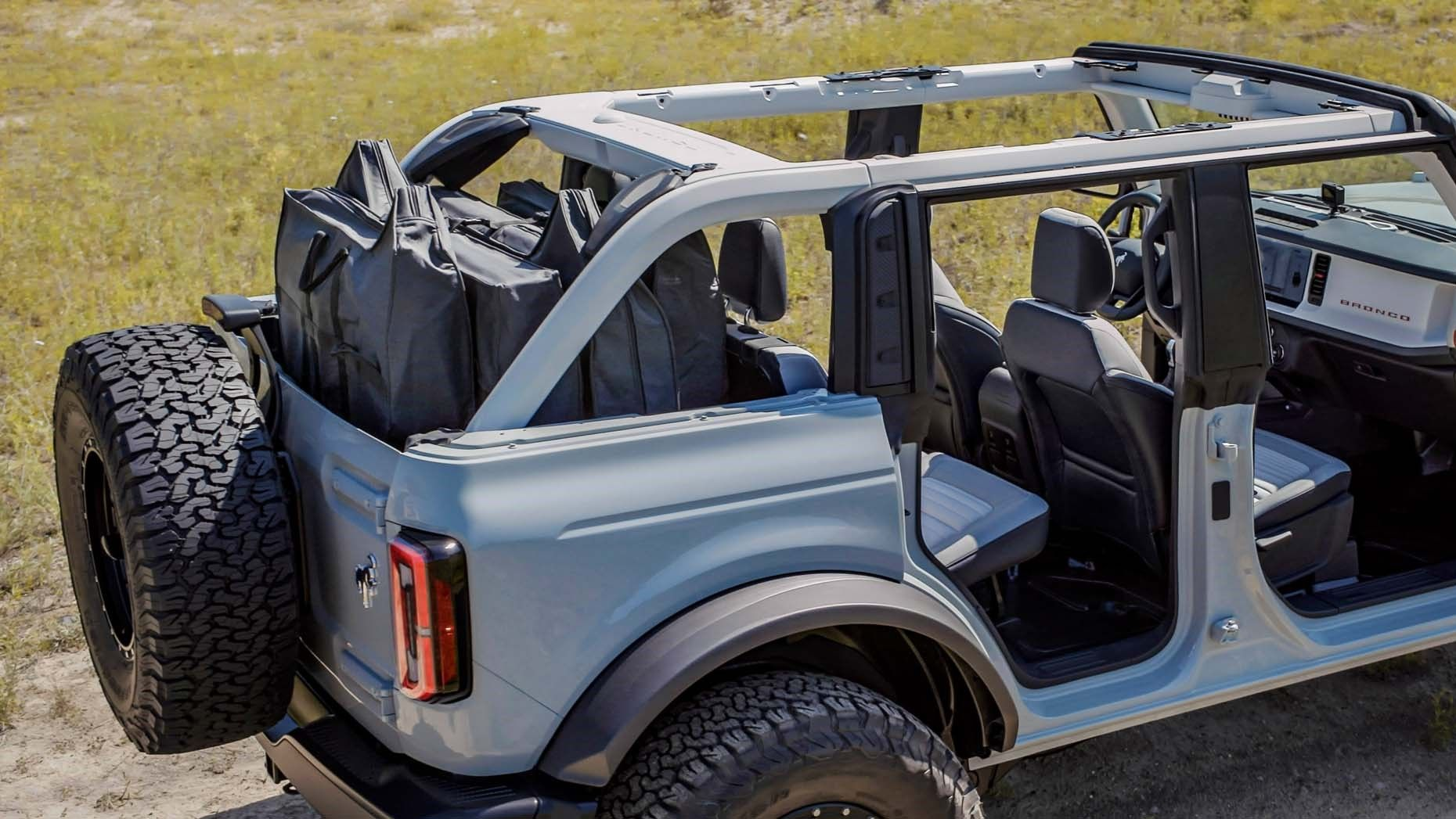 2021 ford bronco 4 door rear quarter roof down view